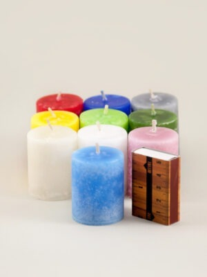 Coloured through marble textured antique candles in various colours. Handmade by Võhma Valgusevabrik