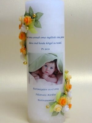 Decorated christening candle whith photo and text