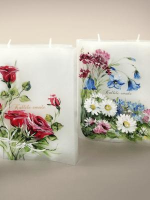 Raamatu kujulised kahe tahiga käsitsi maalitud küünlad. Roosid ja põllulilled